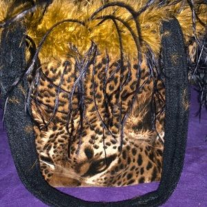 Handbags - Reversible cheetah to zebra purse